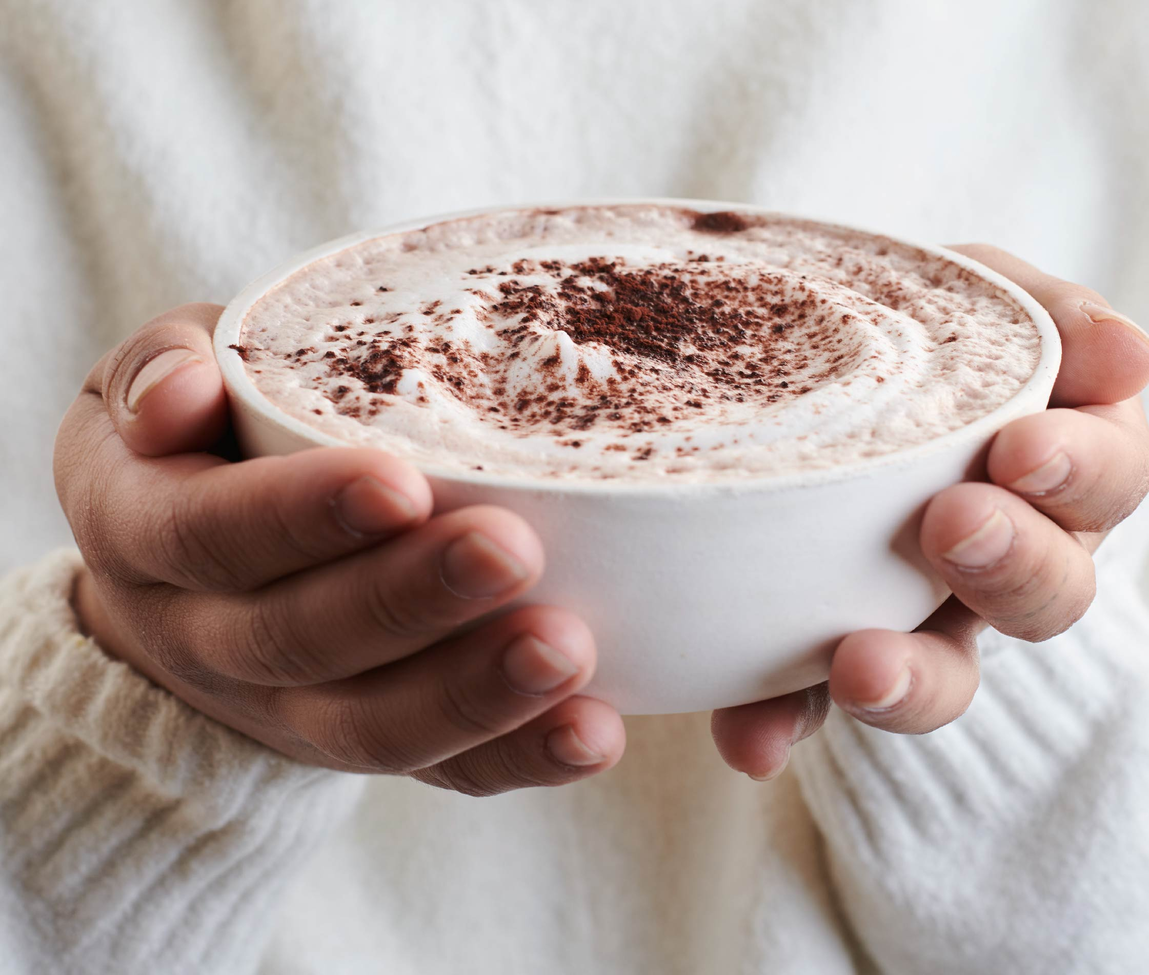 Food Photography with hands holding hot chocolate for Three Trees Almond Milk