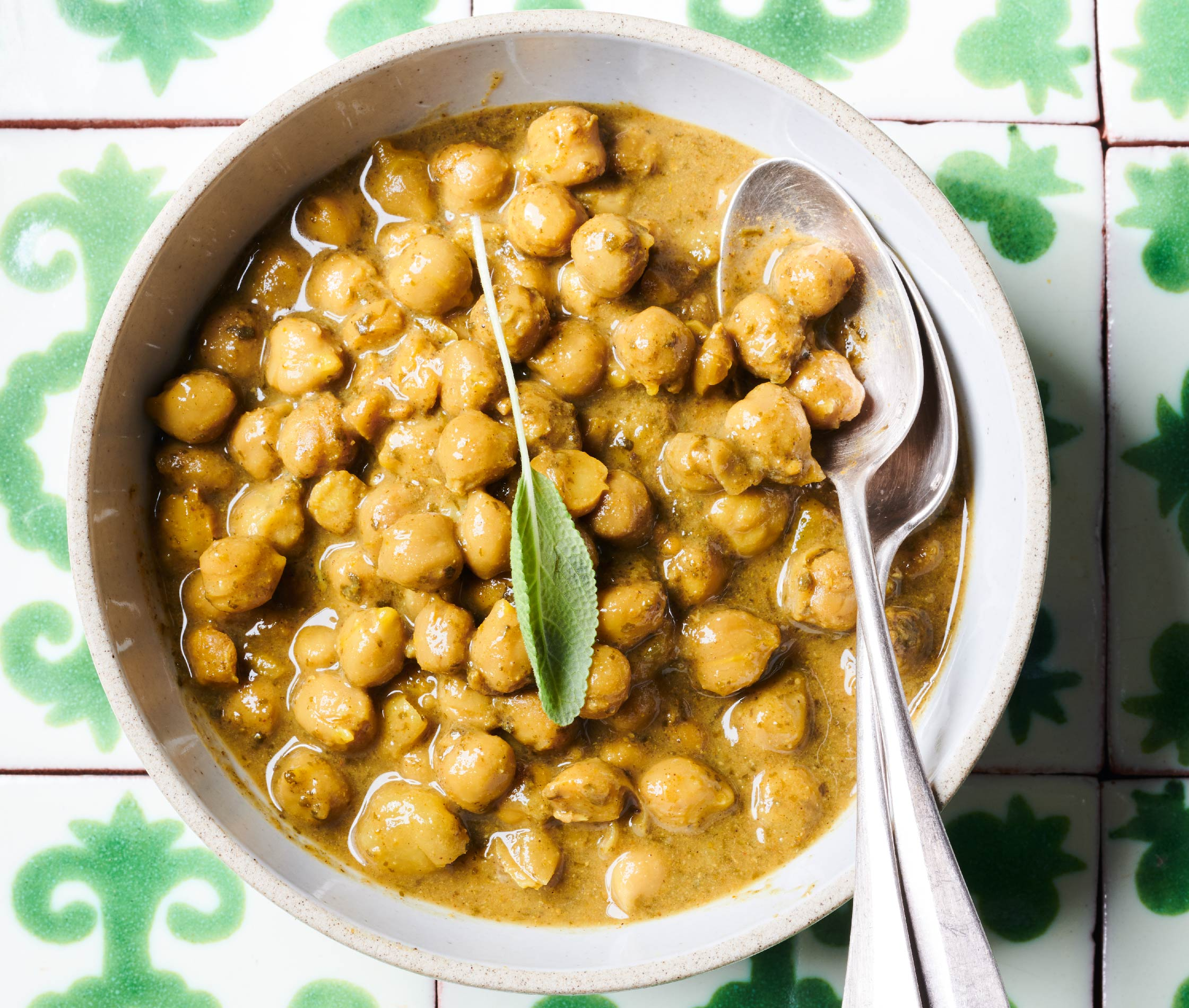 Food photography of trini chickpeas on a tile counter top from a dozen cousins